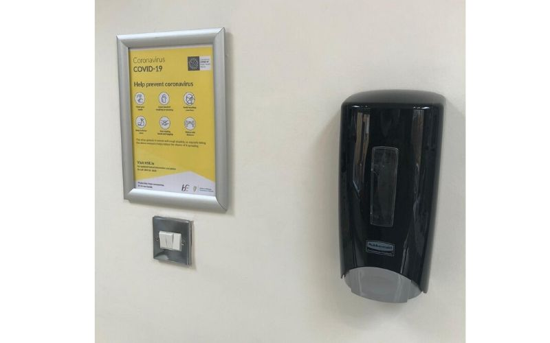 Alert visitors to the need for hand hygiene